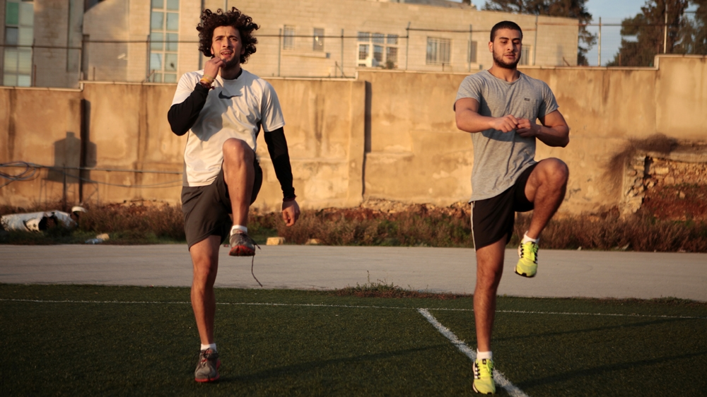 In three years, Khatib has brought his 100m time down from 15 to 11 seconds [Eloise Bollack/Al Jazeera]